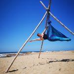Aerial yoga on the beach