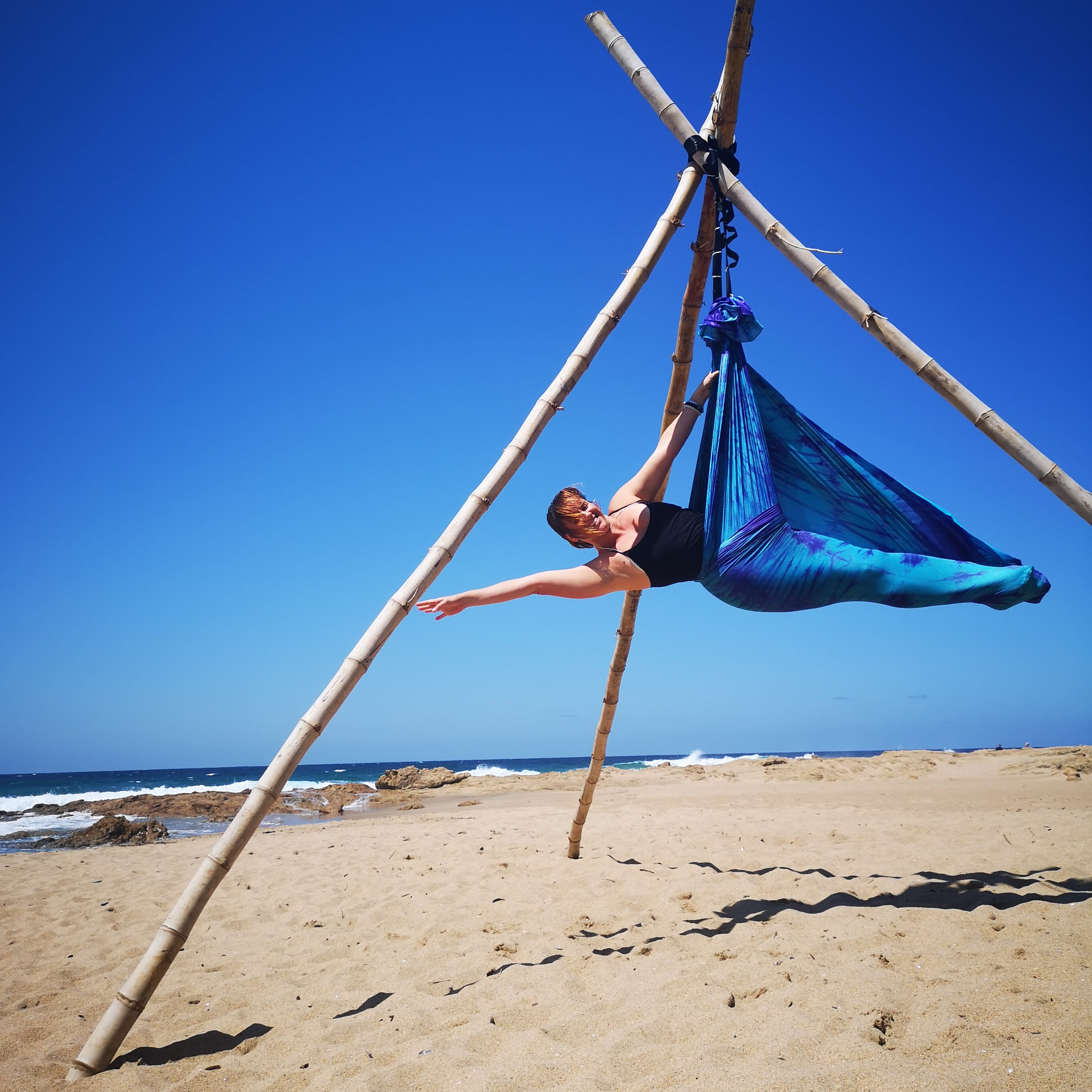 Aerial yoga on the beach