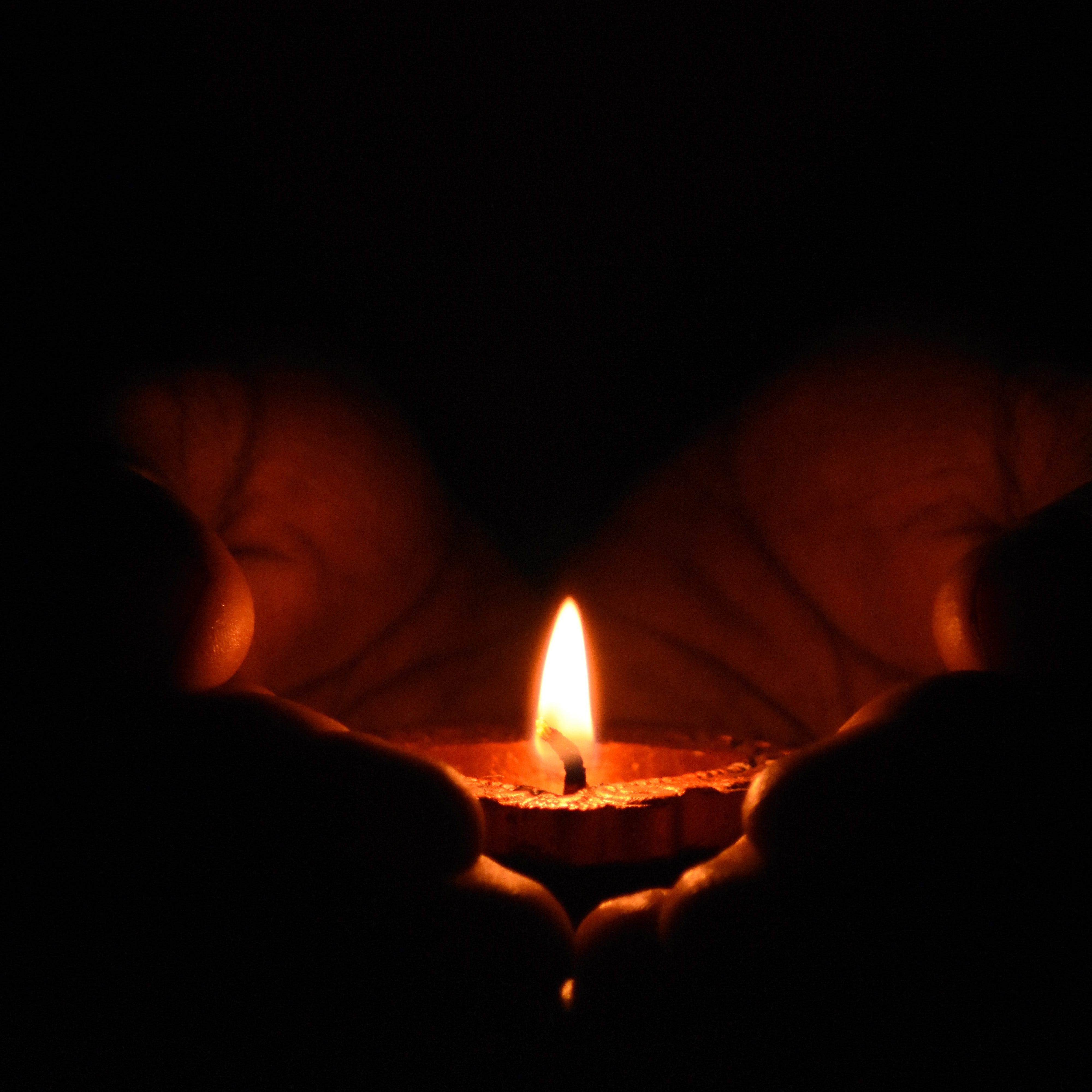 candle light lit yin yoga yoga class relaxation relaxing stress free